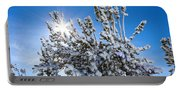 Sunshine Through Snow Covered Tree Portable Battery Charger