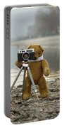 Teddy Bear Taking Pictures With An Old Camera By The Riverside Portable Battery Charger