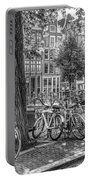The Bicycles Of Amsterdam In Black And White Portable Battery Charger