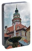 The Cesky Krumlov Castle Tower With A Fountain Below Within The Czech Republic Portable Battery Charger