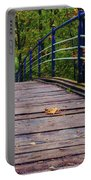 the old bridge over the river invites for a leisurely stroll in the autumn Park Portable Battery Charger