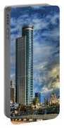 The Skyscraper And Low Clouds Dance Portable Battery Charger by Ron Shoshani