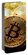 Three Golden Bitcoin Coins On Black Background. Portable Battery Charger