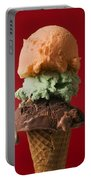 Three Scoop Ice Cream On Red Background Portable Battery Charger