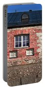 Three Windows On A Brick Wall Portable Battery Charger