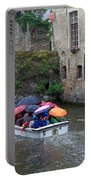 Tourists With Umbrellas In A Sightseeing Boat On The Canal In Bruges Portable Battery Charger