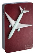 Toy Airplane Over Red Book Cover Portable Battery Charger
