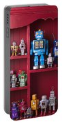 Toy Robots On Shelf  Portable Battery Charger by Garry Gay