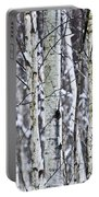 Tree Trunks Covered With Snow In Winter Portable Battery Charger
