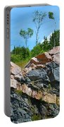 Trees Above The Pink And Grey Rock  Portable Battery Charger