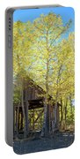 Truckee Shack Near Sunset During Early Autumn With Yellow And Green Leaves On The Trees Portable Battery Charger