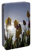 Tulips Blooming With Sun Star Burst Portable Battery Charger