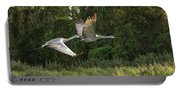Two Florida Sandhill Cranes In Flight Portable Battery Charger