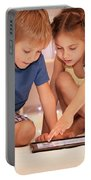 Two Happy Children Playing On The Tablet Portable Battery Charger