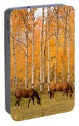 Two Horses Grazing In The Autumn Air Portable Battery Charger