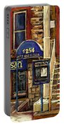 Upstairs Jazz Bar And Grill Montreal Portable Battery Charger by Carole Spandau