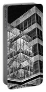 Urban Abstract - Mirrored High-rise Building In Black And White Portable Battery Charger