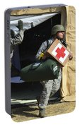 U.s. Air Force Soldier Exits A Medical Portable Battery Charger