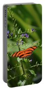 Vibrant Oak Tiger Butterfly Surrounded By Blue Flowers Portable Battery Charger