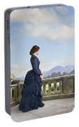 Victorian Woman In A Blue Dress Standing On The Terrace  Portable Battery Charger