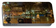 View Of Chess Board In The Middle Of Busy Sidewalk At Night Portable Battery Charger