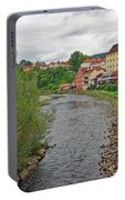Vltava River As It Runs Slowly Through Cesky Krumlov In The Czech Republic Portable Battery Charger