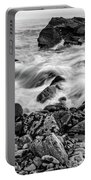 Waves Against A Rocky Shore In Bw Portable Battery Charger by Doug Camara