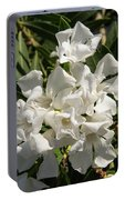White Flowers On Green Leaves Portable Battery Charger