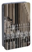 White Wrought Iron Gate In Chicago Portable Battery Charger