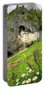 Wildflowers On Hillside At Predjama Castle 1570 Renaissance Fort Portable Battery Charger