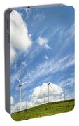 Wind Turbines On A Hill Under A Blue Sky Portable Battery Charger