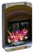 Window Sill Flower Arrangement At Cesky Krumlov Castle In The Czech Republic Portable Battery Charger