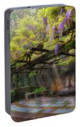 Wisteria Flowers Blooming On Trellis Over Water Fountain Portable Battery Charger