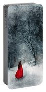 Woman In Red Cape Walking In Snowy Woods Portable Battery Charger