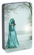 Woman In Snowy Landscape Portable Battery Charger