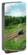 Woman Planting Garden Near Barn Portable Battery Charger