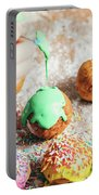 Woman's Hand Coating A Donut With Green Frosting. Portable Battery Charger