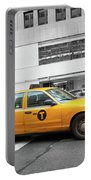 Yellow Cab In Manhattan With Black And White Background Portable Battery Charger