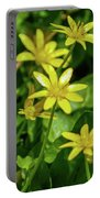 Yellow Flowers On A Green Carpet Portable Battery Charger