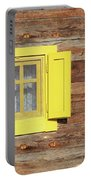 Yellow Window On Wooden Hut Wall Portable Battery Charger