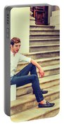 Young Businessman Sitting On Stairs, Relaxing Outside Portable Battery Charger