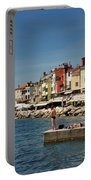 Young Couple Fishing Reading Sunbathing On Dock At Piran Sloveni Portable Battery Charger
