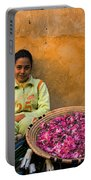 Young Girl Selling Rose Petals In The Medina Of Fes Morroco Portable Battery Charger