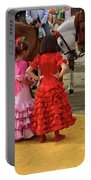 Young Girls In Flamenco Dresses Looking At Horses At The April F Portable Battery Charger
