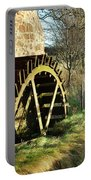 old mill wheel and stream at Preston Mill, East Linton Portable Battery Charger