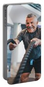 Senior Man Exercising With Ropes At The Gym. Portable Battery Charger