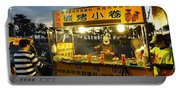 Street Vendor Cooks Grilled Squid Portable Battery Charger