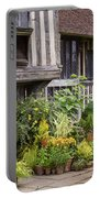 Great Dixter House And Gardens Portable Battery Charger by Perry Rodriguez