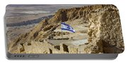 An Israeli Flag Flies Near The Entrance To The Top Of Masada In  Portable Battery Charger