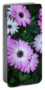 Beautiful Pink Flowers In Grass Portable Battery Charger